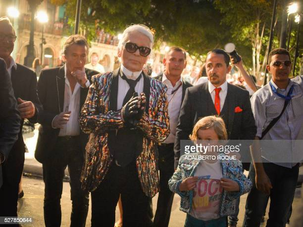 German fashion designer artist and photographer Karl Lagerfeld attends his performance for Chanel at the Prado promenade in Havana on May 3 2016 with...