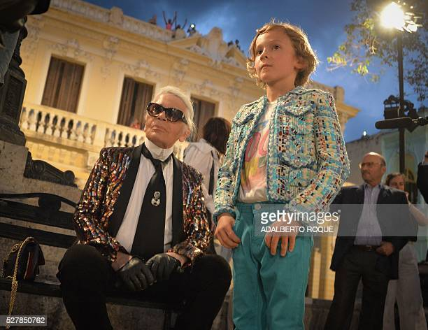 German fashion designer artist and photographer Karl Lagerfeld attends his performance for Chanel at the Prado promenade in Havana on May 3 with his...