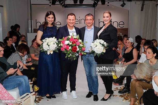 German fashion designer Guido Maria Kretschmer and CEO of Heinrich Heine GmbH Juergen Habermann with models during the Guido Maria Kretschmer...