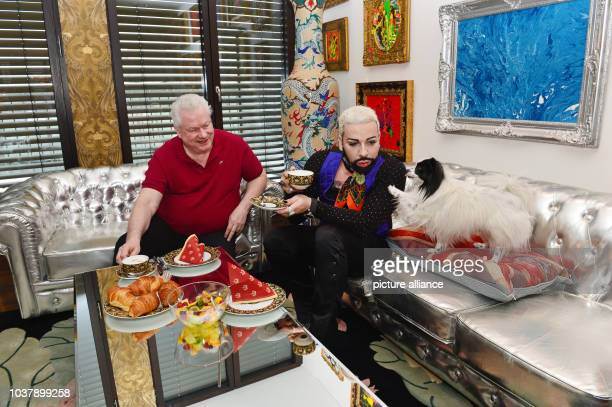 DPA EXKLUSIVE German fashion designer Harald Gloeoeckler and his partner Dieter Schroth pose with their Papillon dog Billy King in their penthouse...