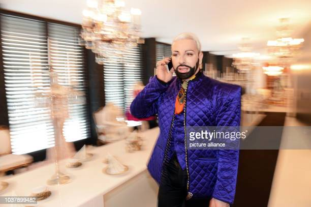 German fashion designer Harald Gloeoeckler telephones in his penthouse apartment in Berlin, Germany, 28 January 2014. Gloeoeckler is one of the most...