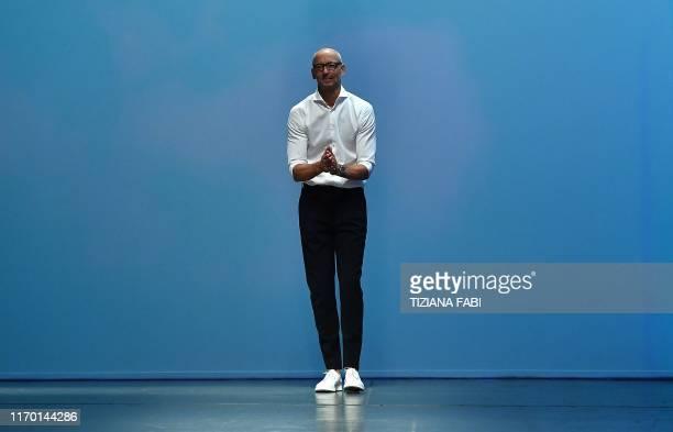 German fashion designer Ingo Wilts acknowledges applause following the presentation of the Hugo Boss Women's Spring Summer 2020 fashion show...