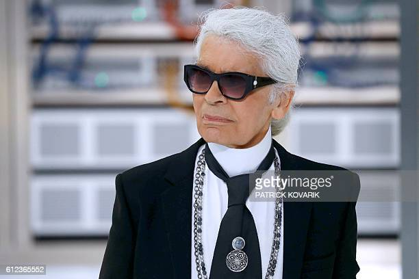 German fashion designer Karl Lagerfeld acknowledges the audience at the end of the Chanel 2017 Spring/Summer readytowear collection fashion show on...