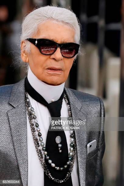 German fashion designer Karl Lagerfeld acknowledges the audience at the end of the Chanel during the 2017 spring/summer Haute Couture collection on...