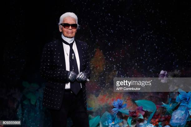 German fashion designer Karl Lagerfeld acknowledges the audience at the end of Fendi 20172018 fall/winter Haute Couture collection in Paris on July 5...