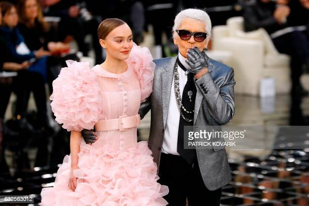 TOPSHOT German fashion designer Karl Lagerfeld acknowledges the audience next to French and US actress and model LilyRose Melody Depp at the end of...