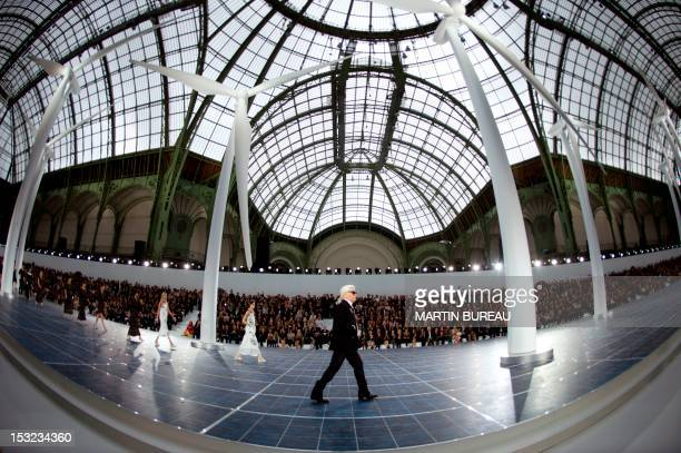 German fashion designer Karl Lagerfeld acknowledges the public at the end of the Chanel Spring/Summer 2013 ready-to-wear collection show on October...