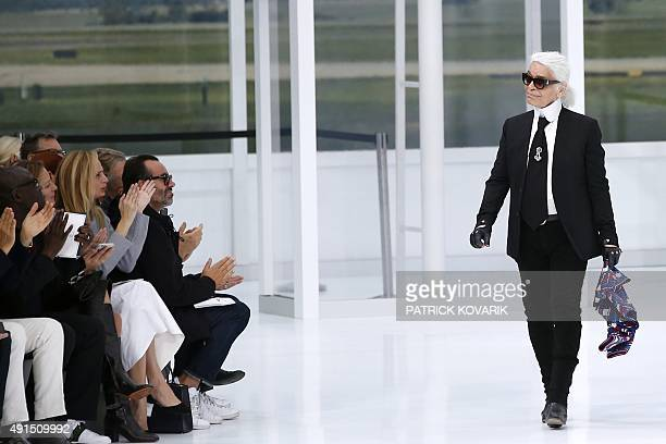 German fashion designer Karl Lagerfeld acknowledges the public at the end of the Chanel 2016 Spring/Summer readytowear collection fashion show on...