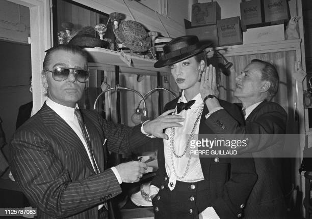 German fashion designer Karl Lagerfeld and French hairdresser Alexandre de Paris prepare on January 24 1983 a model backstage ahead of the...
