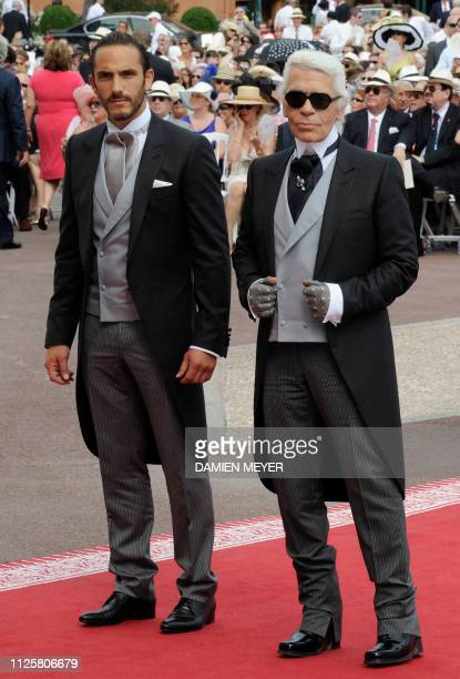 German fashion designer Karl Lagerfeld and his assistant Sebastien Jondeau arrive for the religious wedding of Prince Albert II of Monaco and...