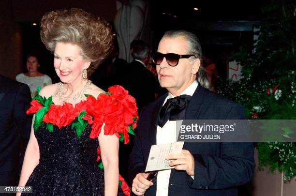 German fashion designer Karl Lagerfeld arrives on August 7 1992 with an unidentified person at the Red Cross Gala ball in Monaco The annual event is...