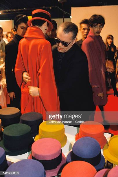 German fashion designer Karl Lagerfeld backstage with models prior to his Ready to Wear Autumn Winter 1989 collection