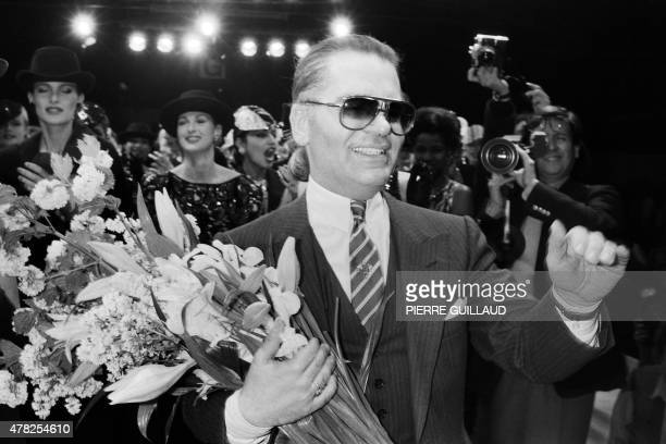 German fashion designer Karl Lagerfeld flanked with models acknowledges the public after the Chanel autumnwinter 1984/1985 readytowear collection...