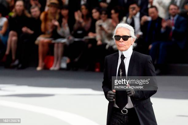 German fashion designer Karl Lagerfeld for Chanel acknowledges the public during the Fall/Winter 20132014 readytowear collection show on March 5 2013...