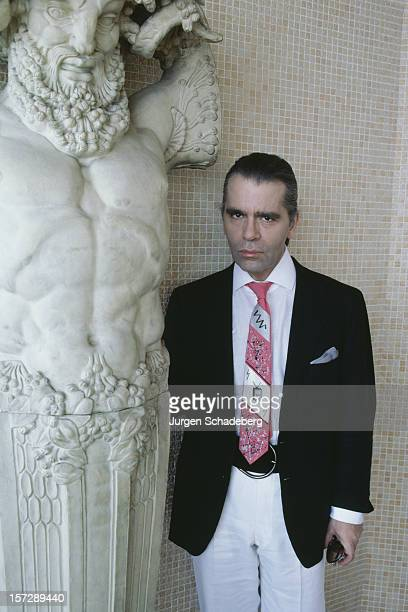 German fashion designer Karl Lagerfeld poses with a piece of sculpture 1984