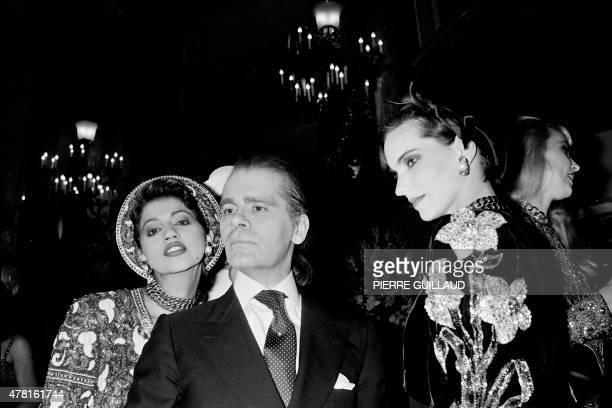 German fashion designer Karl Lagerfeld poses with models on July 23 1984 at the end of the autumnwinter 1984/1985 Haute Couture collection in Paris...