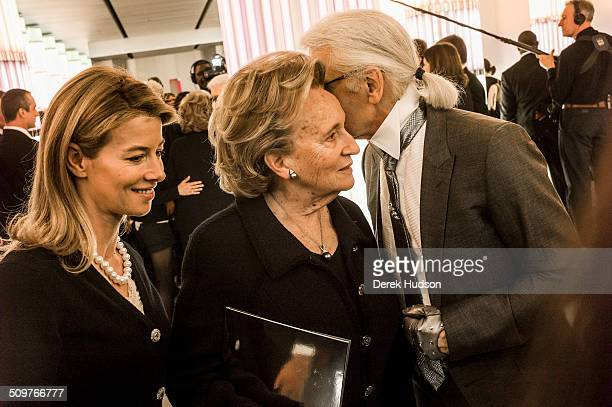 German fashion designer Karl Lagerfeld talks with the former French president's wife Madame Bernadette Chirac during a fashion show at his Chanel...