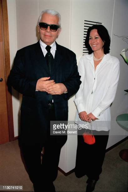 German fashion designer Karl Lagerfeld with British fashion consultant Amanda Harlech at a party for his couture house at the Nobu restaurant London...