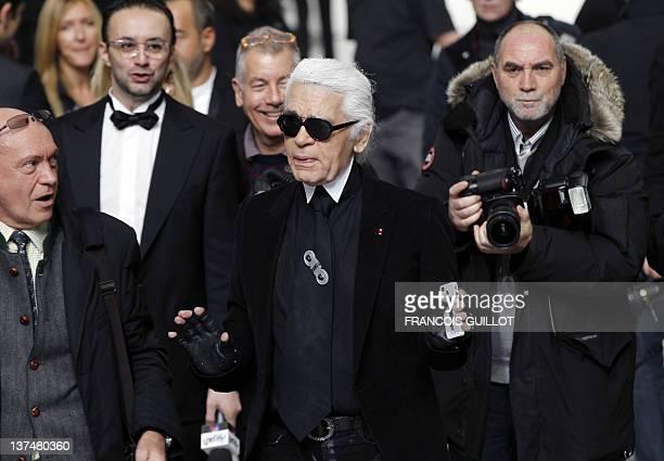 German fashion designer Karl Lagerfield is pictured at the end of Belgian designer Kris Van Assche's Men's AutumnWinter 2012/2013 fashion collection...