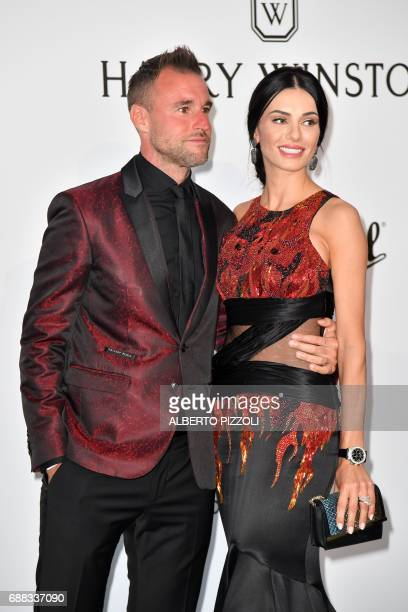 German fashion designer Philipp Plein and Romanian model Andreea Sasu pose as they arrive for the amfAR's 24th Cinema Against AIDS Gala on May 25...