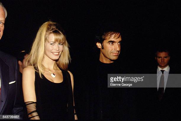 German Fashion model Claudia Schiffer and American magician and illusionist David Copperfield on the set of the film PrêtàPorter directed by American...