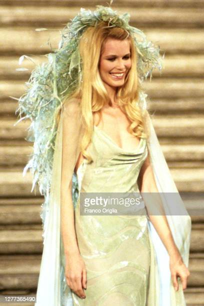 German fashion model Claudia Schiffer wears an evening gown by Valentino during the High Fashion Fall - Winter 1996/97 'Donna Sotto Le Stelle' show...