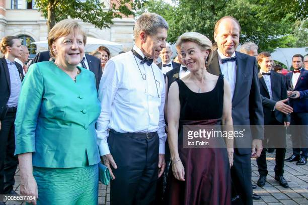 German Federal Chancellor Angela Merkel and her husband Joachim Sauer German Defence minister Ursula von der Leyen and her husband Heiko von der...
