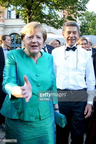 German Federal Chancellor Angela Merkel and her husband Joachim Sauer during the opening ceremony of the Bayreuth Festival at Bayreuth Festspielhaus...