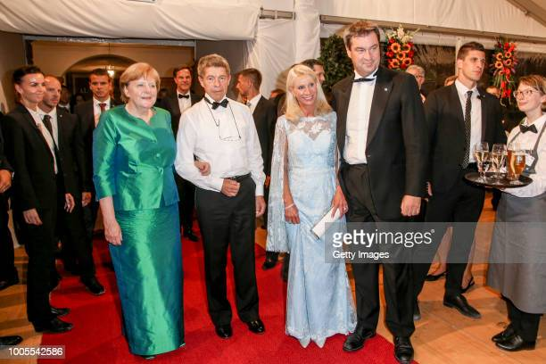 German Federal Chancellor Angela Merkel and her husband Joachim Sauer Bavarian State prime Minister Markus Soeder and his wife Karin baumueller...