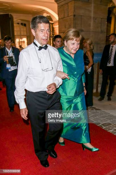 German Federal Chancellor Angela Merkel and her husband Joachim Sauer attend the Bayreuth Festival 2018 state reception at Neues Schloss on July 25...