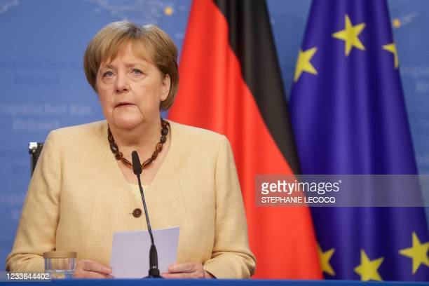 German Federal Chancellor Angela Merkel gives a press conference at the end of the second day of an EU summit at the European Council building in...