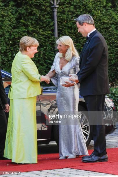 German Federal Chancellor Angela Merkel, Karin Baumueller and her husband German politician Markus Soeder during the Bayreuth Festival 2019 opening...