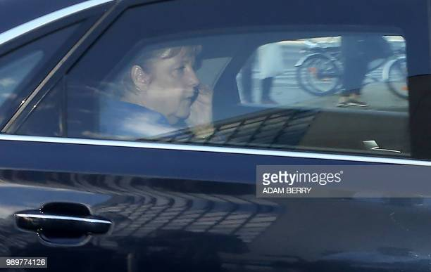 German Federal Chancellor Angela Merkel speaks on her mobile phone as she arrives at the German Christian Democrats headquarters in Berlin in the...