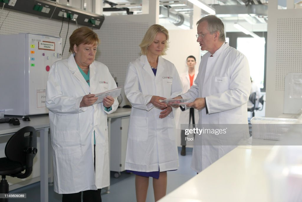 DEU: Merkel Visits Centogene Biotech In Rostock