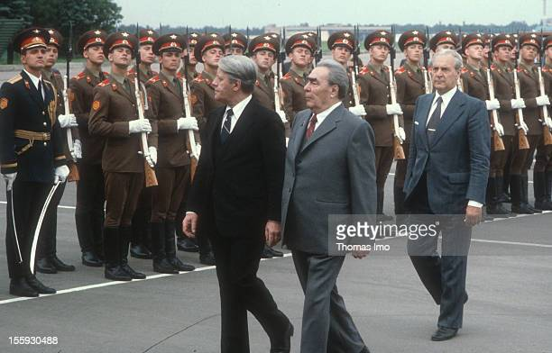 German Federal Chancellor Helmut Schmidt is being welcomed by Leonid Breschnew with military honours at the Airport Wnukowo 2 the Head of the...