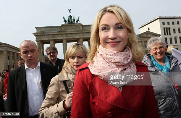 German Federal Family Minister Manuela Schwesig attends the 'Equal Pay Day' demonstration in front of the Brandenburg Gate on March 21 2014 in Berlin...
