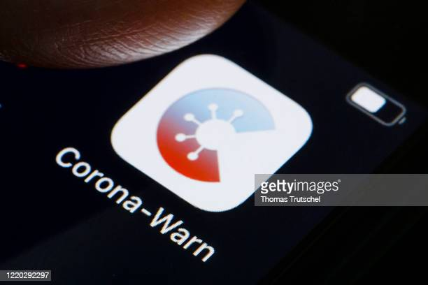 German federal health ministry's CoronaWarnApp software is displayed on a smartphone on June 16 2020 in Berlin Germany Germany launched its contact...