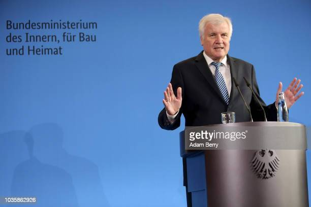 German Federal Interior Minister Horst Seehofer speaks during a news conference in the federal interior ministry on September 19 2018 in Berlin...
