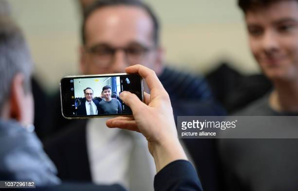 German federal justice minister Heiko Maas poses with pupils for a picture at the Bertha von Suttner High School in Potsdam Germany 23February 2016...