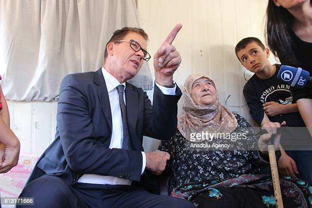 German Federal Minister for Economic Cooperation and Development Gerd Muller visits the container city in which Syrians take shelter in Nizip...