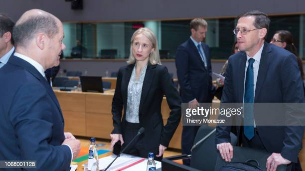 German Federal Minister of Finance Olaf Scholz is talking with the Polish Finance Minister Teresa Czerwinska and the Hungarian Finance Minister...