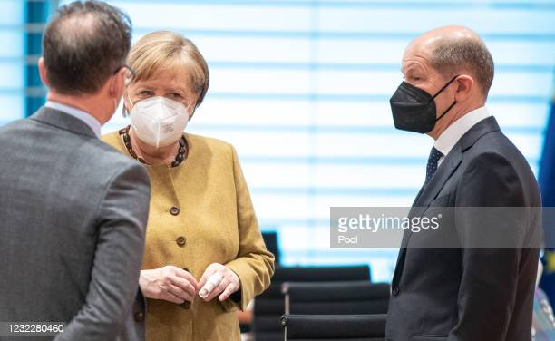 German Federal Minister of Foreign Affairs Heiko Maas, Chancellor Angela Merkel and Federal Minister of Finance and Vice Chancellor Olaf Scholz speak...