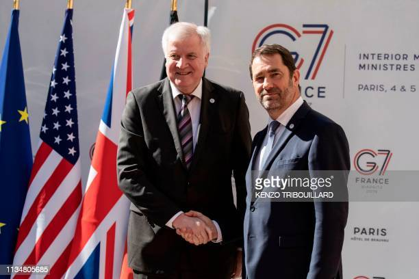 German federal minister of Interior Horst Seehofer shakes hands with French Interior Minister Christophe Castaner as he arrives for a meeting at the...