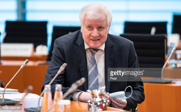 German Federal Minister of the Interior, Building and Community Horst Seehofer looks on during the weekly government cabinet meeting during the third...