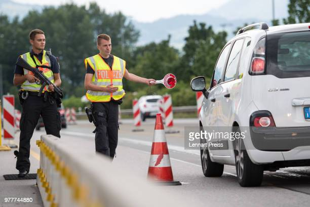 German federal police check cars arriving from Austria on the A93 highway near the GermanAustrian border on June 18 2018 near Kiefersfelden Germany...