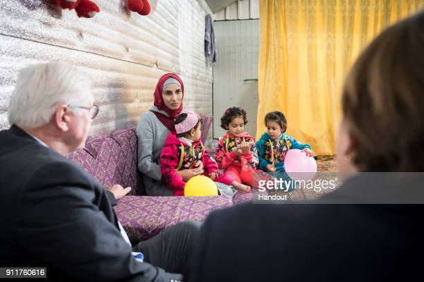 German Federal President FrankWalter Steinmeier and his wife Elke Büdenbender speak with a refugee family from Syria in refugee camp AlAzraq on...
