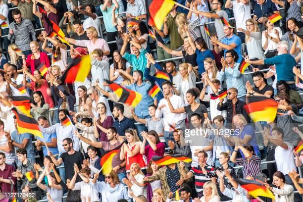 deutsche venn wehende fahnen auf einem stadion - weltmeisterschaft stock-fotos und bilder
