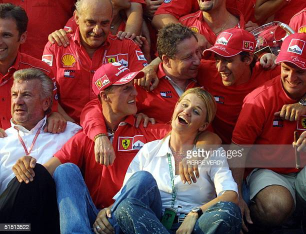 German Ferrari 2001 World Champion Michael Schumacher sits among his wife Corinna his manager Willi Weber of Germany French team manager Jean Todt...