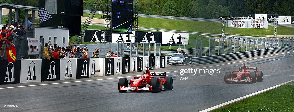 German Ferrari driver Michael Schumacher crosses t : News Photo
