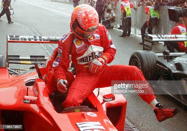 German Ferrari driver Michael Schumacher gets out of his car as he set the 2nd time on the grid at the end of the qualifying session on the...